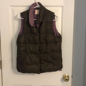 Brown puffer vest with plaid interior